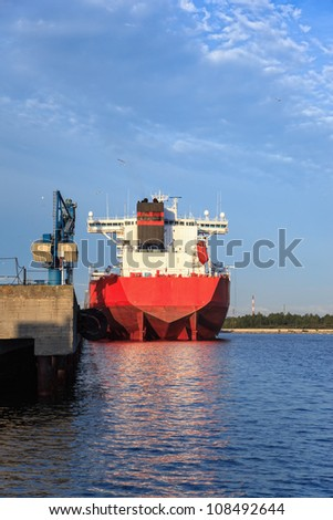 Large cargo ship moored at the quay. - stock photo
