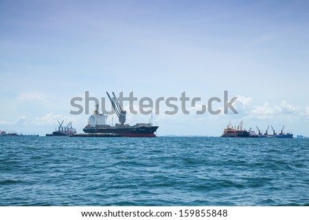 large cargo ship. Moored offshore. Transport near the docks. - stock photo