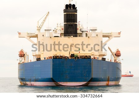 large cargo ship on the ocean - stock photo
