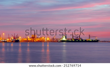 large cargo ship over the sea at night (long exposure)