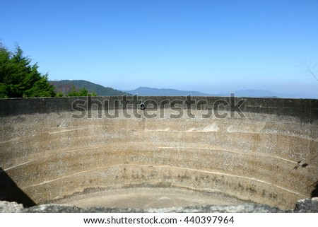 Large cement pond for storing water, pond for keeping water on the mountain, used for irrigation of farmers - stock photo