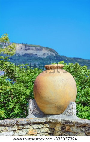 Large Ceramic Pot in front of the Hill - stock photo