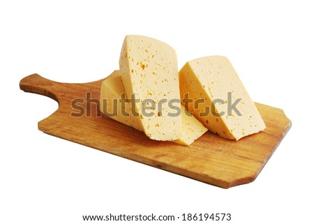 Large chunks of cheese on a wooden board