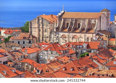 Large church building surrounded by orange roof tops in the old town of Dubrovnik, Croatia - stock photo