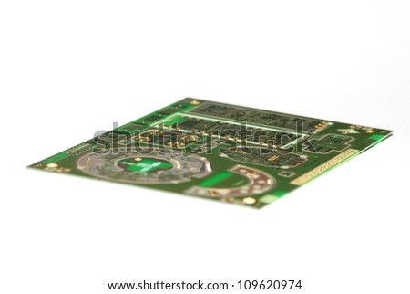 large circuit board with small electric components on white background - stock photo