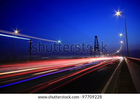 Large city road night scene, night car rainbow light trails - stock photo