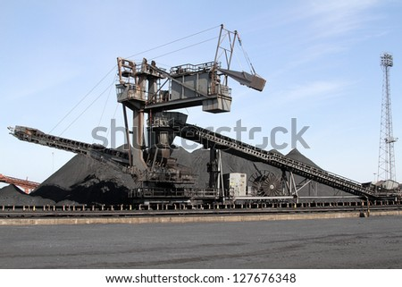 Large coal stacking machine in operation.