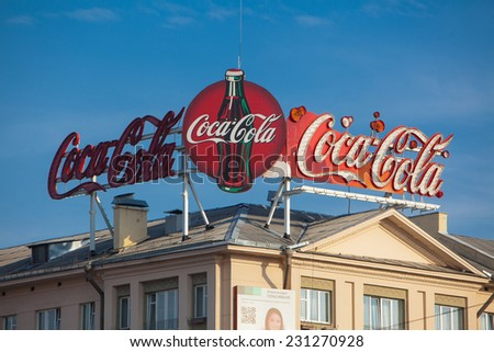 Large Coca Cola sign on the roof.Advertising object in town. Belarus,Minsk,November,4,2014