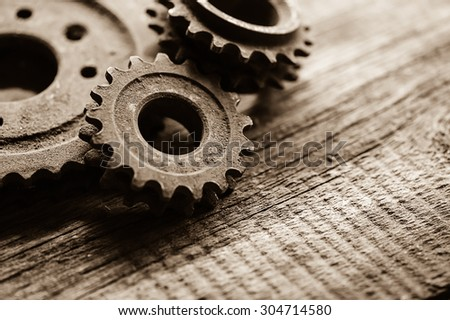Large cog wheels in the motor - stock photo