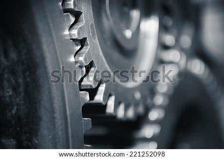 Large cog wheels in the motor - blue toned - stock photo