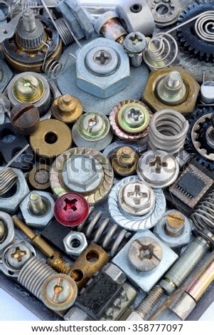 Large collection of various metal elements as screws, bolts, heads, nuts.....