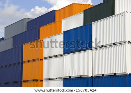 Large colorful sea containers stacked in the harbor of Rotterdam, Holland - stock photo