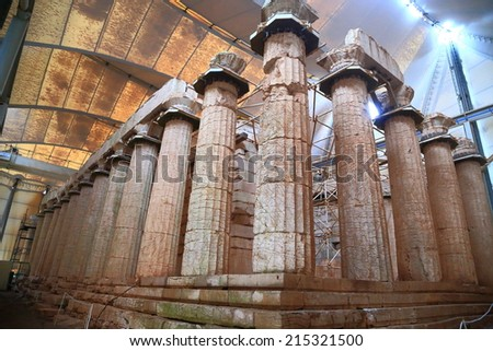 Large columns of the Apollo temple at Bassae covered with large canopy, Greece - stock photo