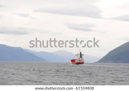 Large commercial boat in norvegian fjords - stock photo