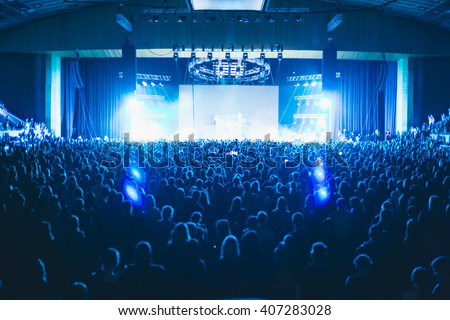 Large concert hall filled with spectators before the stage. - stock photo
