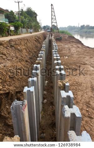 Large concrete construction to prevent soil erosion, coastal rivers. - stock photo