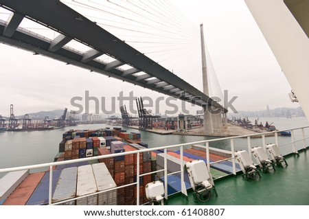 large container ship approaching Stone-cutters Bridge, Rambler Channel, HONGKONG - stock photo