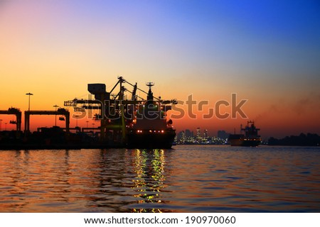 Large container ship arriving in port at morning - stock photo