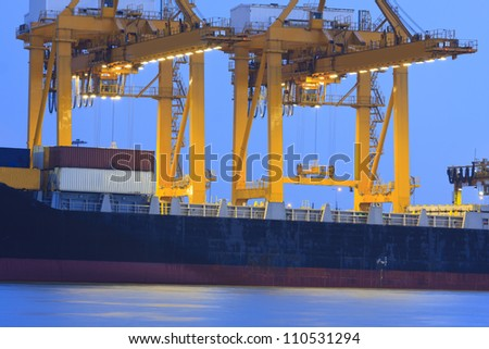 Large container ship in a dock at harbor - stock photo
