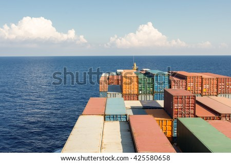 Large container ship move forward to ocean, evening day time. - stock photo