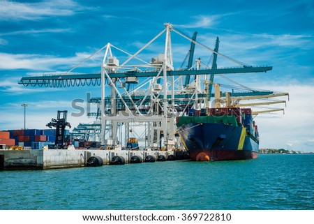 Large container vessel unloaded in Port of Miami - stock photo