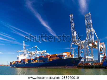 Large container vessel unloaded in Port of Rotterdam - stock photo