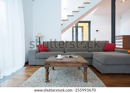 Large couch in living room in the residence - stock photo