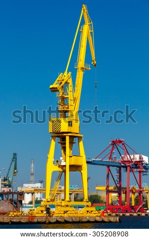 Large cranes on a pier in the seaport of Gdansk.