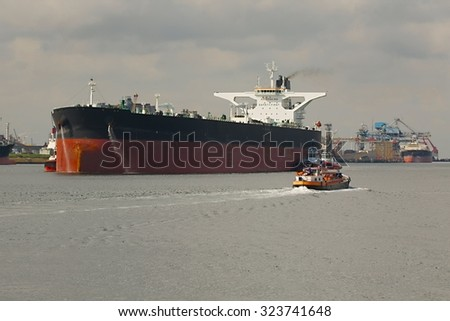 Large crude oil tanker ship coming into port - stock photo