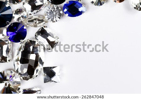 Large crystal strasses on a white background - macro photo - stock photo