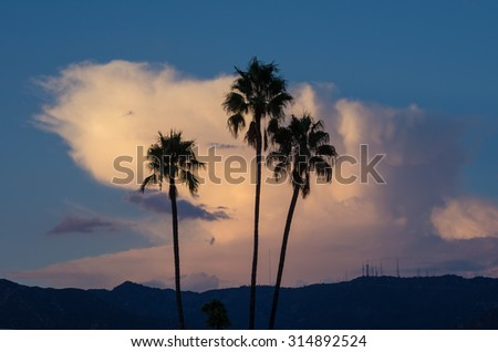 Large cumulonimbus clouds over the San Gabriel Mountains in California, USA. Mount Wilson is on the right hand side of the frame. Photo taken from Pasadena. - stock photo