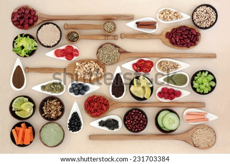 Large diet and weight loss super food selection in bowls and wooden spoons over mottled cream background. - stock photo