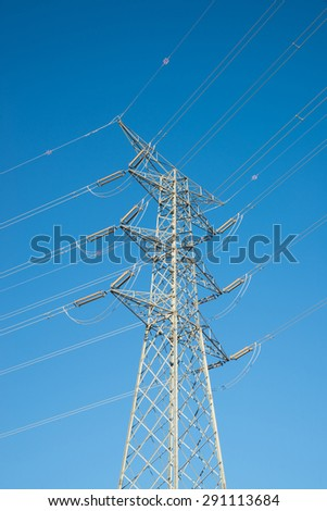 Large electricity pylon and wires of the power line - stock photo
