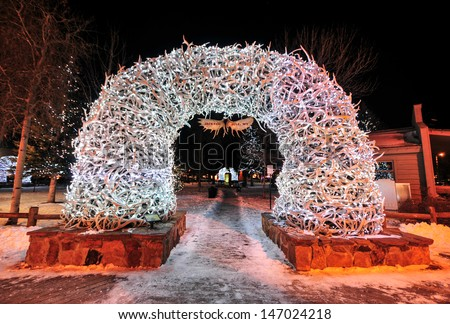 Large elk antler arches curve over Jackson Hole, Wyoming's square's four corner entrances. The antlers have been there since the early 1960s, and new arches are currently assembled to replace them. - stock photo