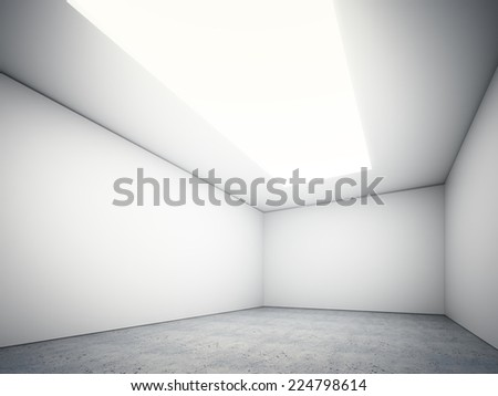 Large empty room with a top ceiling light and a concrete floor - stock photo