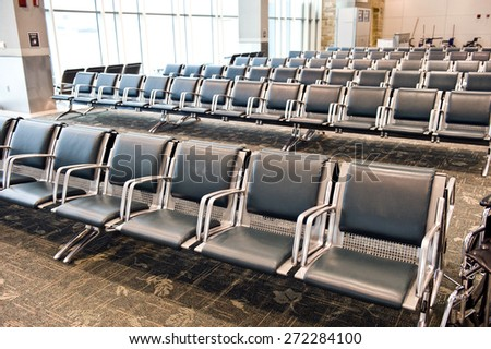 Large Empty Seating Inside Airport - stock photo