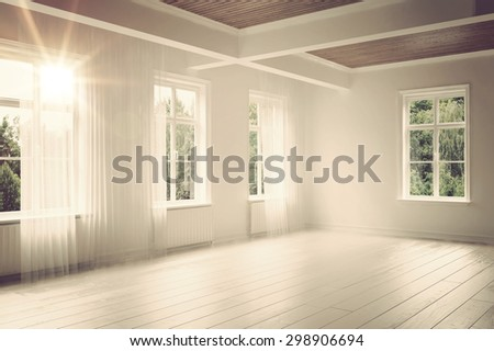 large empty spacious bright white loft room lit by numerous windows overlooking green trees for your