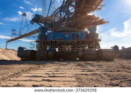 Large excavator machine in the mine - stock photo