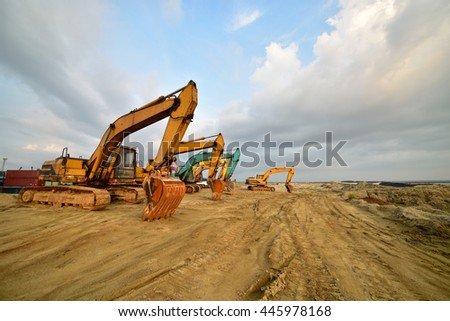 Large excavator under the blue sky white clouds - stock photo