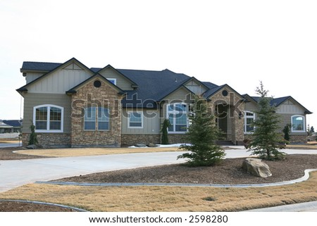 Large expensive house with stone on front - stock photo