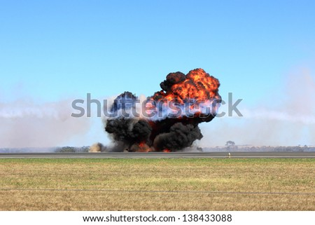 Large explosion with fire ball and smoke at a public display - stock photo