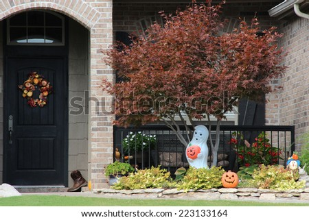Large fall wreath on a door - stock photo
