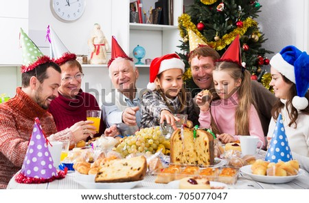 Large Family Enjoying Festive Meal During Christmas Dinner At Home