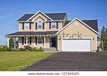 Large family home in a rural area. - stock photo