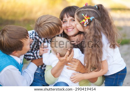 Large family hugging and having fun outdoors. Summer vacation. - stock photo