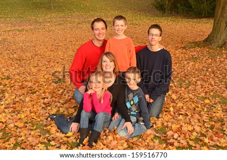 large family in autumn leaves - stock photo