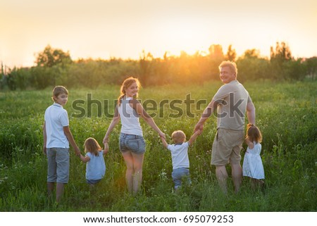 Large family on a walk with children