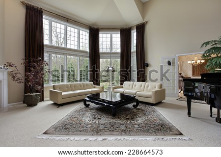 Large family room with two story windows