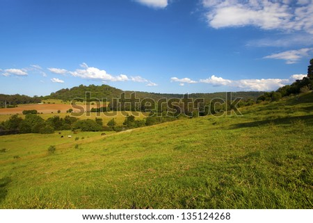 Large farm property against a blue sky
