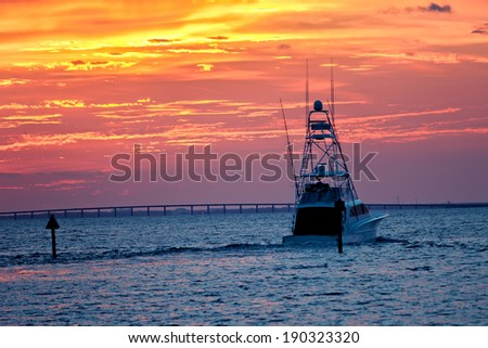Large fishing boat going out for sunset cruise in Destin, Florida - stock photo